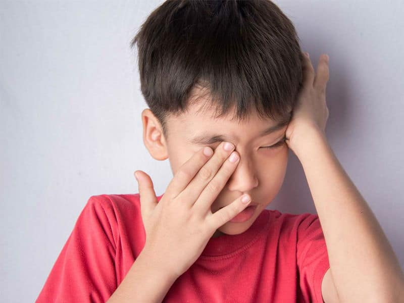 Child experiencing eye strain